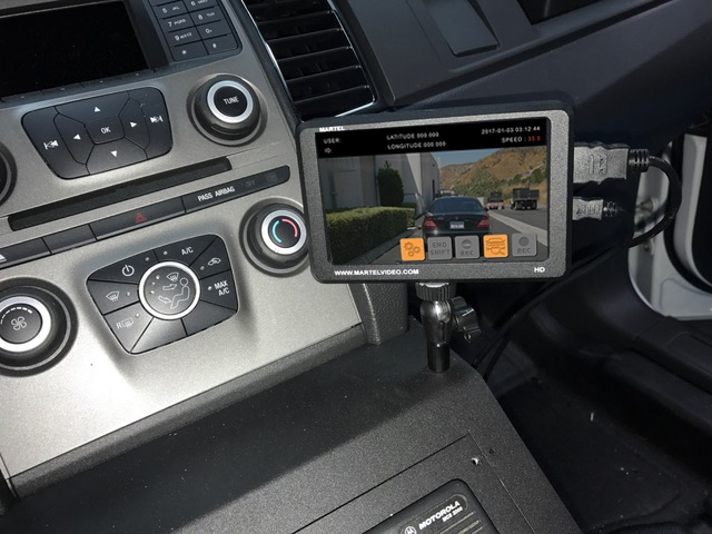 in-car video camera mounted on console in police car